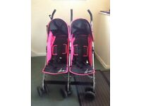 Double buggy excellent condition with rain cover.
