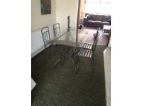 Glass Dining Table With 4 Matching Black Cast Iron Chairs