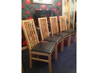 Set of 4 light oak dining chairs
