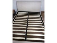 Cream upholstered double bed frame