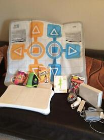 Wii fitness with Wii mat, belt and games.