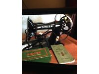 Singer sewing machine built into table.