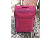 Revelation 29in large expandable 4-wheel suitcase used twice sturdy lightweight