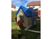 Child's inflatable little tikes play house.