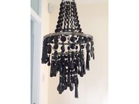 Beaded light pendant shade with black glass beads hung from silver rings