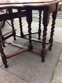 An old oak gate leg table drop leaf with barley twist legs