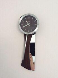 Walnut and mirror glass clock