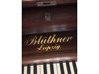 Superb Bluthner upright superb serviced and tuned with candle stick holders