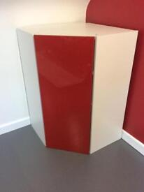Ikea corner unit cupboard. In as new condition. Gloss red. 2 available.