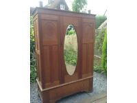 Elegant darkwood wardrobe with drawer below, oval mirror, good condition, assembly from 4 pieces.
