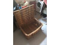 Large wicker chest with leather straps. Excellent condition. Vintage