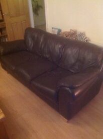 Brown leather 3 seater sofa, good condition.
