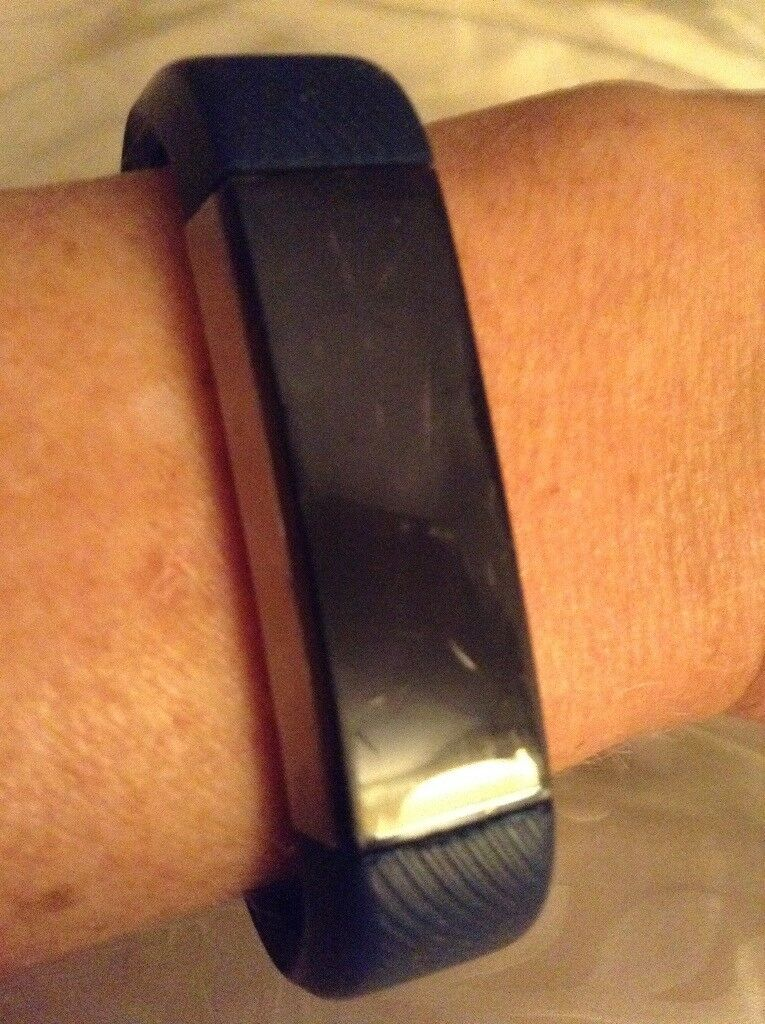 Fitbit Alta (small) with blue strap and charger