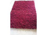 Dumroo : 100% polyester shag pile rug handmade in India. 120 x 180cm crimson very good condition