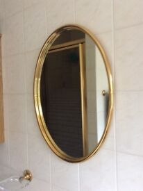 Oval gold framed bathroom mirror