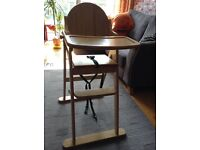 Pine high chair from East Coast, excellent condition. Folds for easy storage