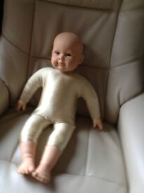 Baby massage demonstration doll New never used removable body suit excellent condition length 60cm