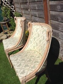 Antique chairs Pair of 20th century stripped beech bergeres in the empire style swan neck