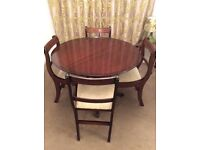 Beautiful dark wood 'Regency' dining table and 4 chairs