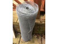 Galvanised wire fence