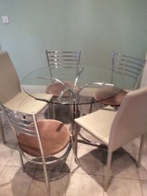 Glass table and five chairs