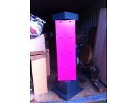 Beautiful pink revolving retail display stand