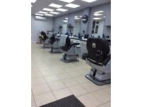 Loui's is a modern barbershop with a high stand of barbering.