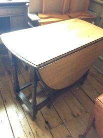 Wooden drop leaf dining table