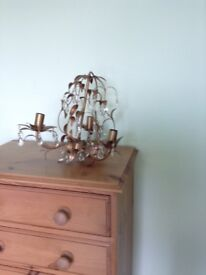 Laura Ashley chandelier and matching wall lights.