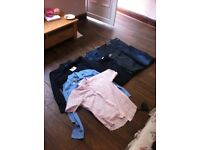 Job lot of unused designer jeans and shirts