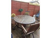 Garden furniture...wooden dining table and four chairs..