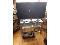 32 inch LG TV, stand and new wall hanger