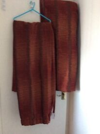 Pair of curtains , reddish brown colour ,lined