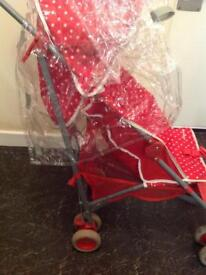 Mothercare Minnie Mouse buggy with rain cover .