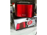 brand new hotpoint toaster still in box (red)
