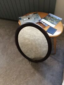 Oval mirror. Dark wood frame. Excellent condition.