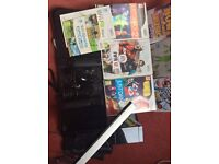 Wii console for sale including balance board six games four hand sets bought