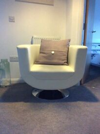 White leather look swivel chair