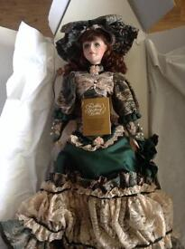 "Musical ""Franklin Heirloom"" Porcelain doll"