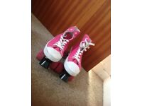 Pink roller boots, size 4. Hardly used, good condition.