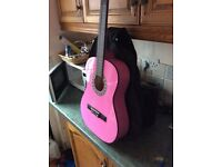 Pink guitar with carry case can deliver