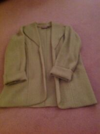 Casual light wool jacket with turned back cuffs.