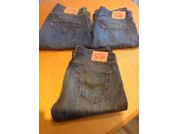 3pairs of Levi Jeans.