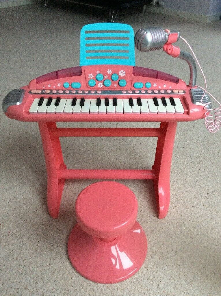 Kids pink electric keyboard, microphone and stool