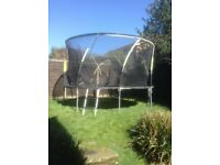 12 ft trampoline with netting and ladder