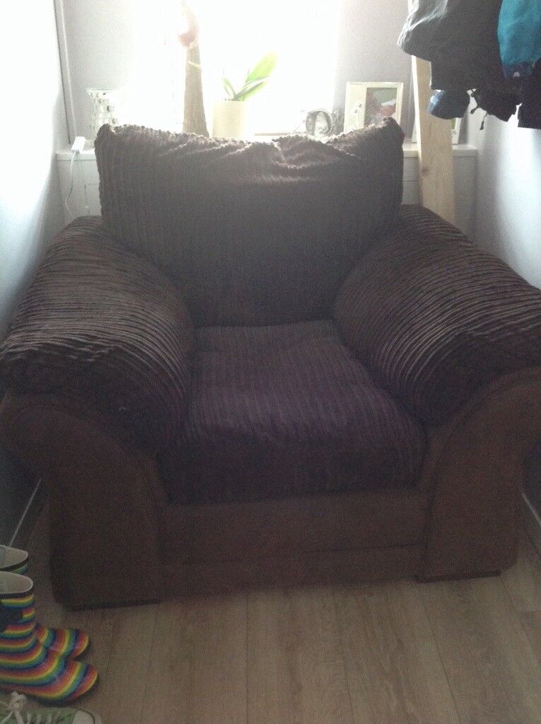 Brown single sofa seat with removable cushions and washable covers.