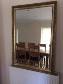 Gold and black framed mirror