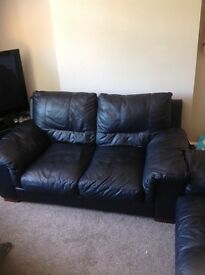 DFS 2 seater and 3 seater black leather sofas