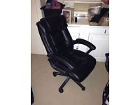 Leather swivel chair with matching leather footrest