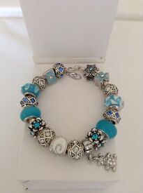 Genuine pandora bracelet complete with european charms